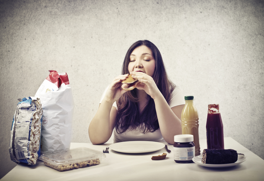 overweight-woman-eating-junk-food
